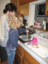 Mark and our then three year old Maddie hard at work washing dishes...
