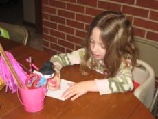 Maddie working hard at handwriting (not her favorite subject)