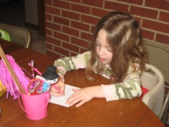 Maddie working hard at handwriting (not her favorite subject)